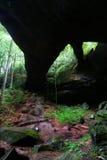 Natural Rock Bridge in Alabama. Natural Rock Bridge towering over the dense forests of Alabama Stock Image