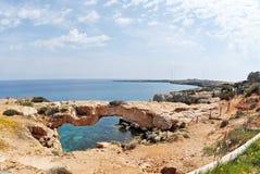 Natural Rock Bridge in Cyprus. View of Cape Greco and Natural rock bridge in Cyprus Stock Images