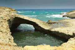 Natural rock bridge in Milos island Royalty Free Stock Photos