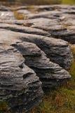 Natural Rock Formation around Poulnabrone Dolmen. Natural Layered Rock Formation at the Edge of Small Little Cliffs made of karstic limestone around Poulnabrone Stock Photo