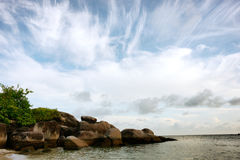 Natural rock formation in the sea at the beach in Belitung Island. Natural rock formation in the sea at the beach in Belitung Island in the morning on a white Stock Image