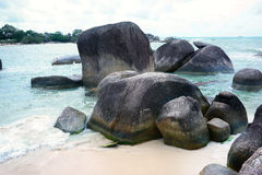 Natural rock formation in the sea and on a white sand beach in Belitung Island. Natural rock formation in the sea and on a white sand beach in Belitung Island Stock Photo