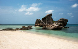 Natural rock formation in the sea and on a white sand beach in Belitung Island. Natural rock formation in the sea and on a white sand beach in Belitung Island Stock Images