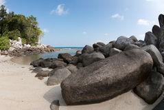 Natural rock formation in the sea and on a white sand beach in Belitung Island, Indonesia. Royalty Free Stock Photo