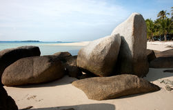 Natural rock formation on white sand beach at the coast in Belitung Island. Stock Images