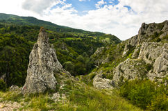 Natural rock formations at Jelasnica gorge at cloudy autumn afternoon Royalty Free Stock Photos
