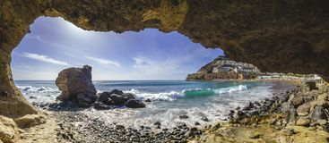 Natural rock grotto on the beach on Playa del Cura, near playa A stock photography