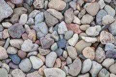 Natural rock pebble backgorund Stock Photos