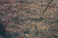 Natural rock wall texture and background.Brown old stone surface textured. Closeup view of stone wall texture and background. Natural rock wall texture and Royalty Free Stock Photography