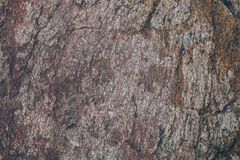 Natural rock wall texture and background.Brown old stone surface textured. Closeup view of stone wall texture and background. Natural rock wall texture and Stock Images
