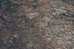 Natural rock wall texture and background.Brown old stone surface textured. Closeup view of stone wall texture and background. Natural rock wall texture and Royalty Free Stock Photos
