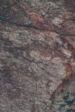 Natural rock wall texture and background.Brown old stone surface textured. Closeup view of stone wall texture and background. Natural rock wall texture and Royalty Free Stock Image