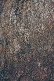 Natural rock wall texture and background.Brown old stone surface textured. Closeup view of stone wall texture and background. Natural rock wall texture and Royalty Free Stock Photo
