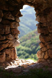 Natural rock window of old fortress. Eco friendly window of fortress ruins Stock Photography