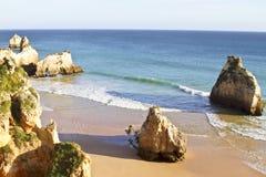 Natural rocks in the Algarve in Portugal. Natural rocks at Praia Tres Irmaos in Alvor  the Algarve in Portugal Stock Photo