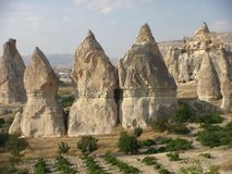 Natural rocks of the Cappadocia in the walk of the pixies  in Turkey. Cream color rocks of the Cappadocia in Turkey. Travel destination. Blue sky. Sunny day Stock Image