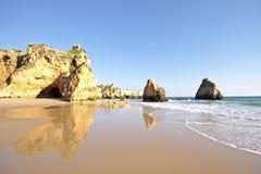 Natural rocks near Alvor Portugal. Natural rocks near Alvor at Praia Tres Irmaos in the Algarve Portugal Stock Image