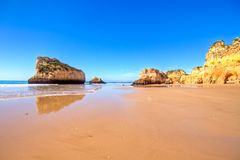 Natural rocks at Praia Tres Irmaos in Portugal Royalty Free Stock Photos
