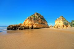 Natural rocks at Praia Tres Irmaos in Portugal Stock Photography