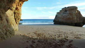 Natural rocks at Praia Tres Irmaos in Portugal stock footage