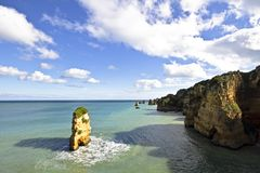 Natural rocks near Lagos in Portugal. Natural rocks at the southcoast near Lagos in Portugal Royalty Free Stock Photo