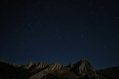 Natural rocks and stars at night Royalty Free Stock Photo