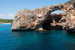 The natural rocky arch at Cala Antena, Majorca Stock Images