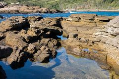 Natural rocky pool in Buzios royalty free stock image