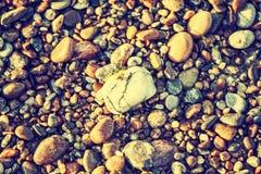 Natural, rocky, stony texture background, retro vintage effect. Royalty Free Stock Photo