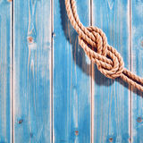 Natural Rope Double Figure Eight Knot on Blue Wood Royalty Free Stock Photos