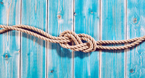 Natural Rope Double Figure Eight Knot on Blue Wood Royalty Free Stock Images