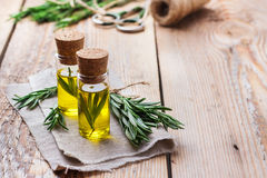 Natural rosemary essential oil for beauty and spa. Healthy lifestyle concept. Natural rosemary essential oil on a rustic wooden table for beauty, spa, therapy Royalty Free Stock Image