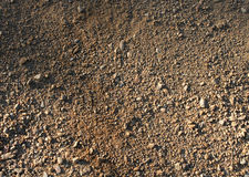 Natural rough sand. Natural brown rough sand gravel small stones background stock images