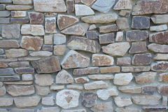 Natural rough stone wall - texture. The wall of natural stone - natural background Stock Photo