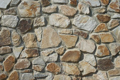 Natural rough stone wall - texture. The wall of natural stone - natural background Royalty Free Stock Photo