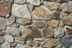 Natural rough stone wall - texture. The wall of natural stone - natural background Stock Photography
