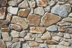 Natural rough stone wall - texture. The wall of natural stone - natural background Royalty Free Stock Images
