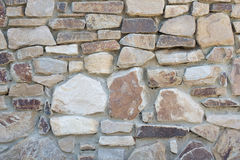 Natural rough stone wall - texture Stock Images