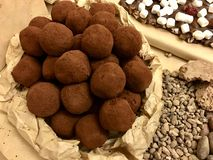 Natural round chocolate candies truffle in craft paper bag, top view, close-up stock photo