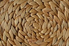 Natural round wicker basket pattern background royalty free stock image