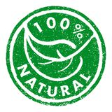 100% NATURAL rubber stamp grunge style. Green leaf round stamp royalty free illustration