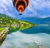 Natural rural landscape. Town and cruise port Olden in Norwegian fjords, hot air balloon Royalty Free Stock Images