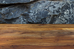 Natural rustic reddish brown wood with exotic natural stone wall Royalty Free Stock Image