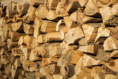 Natural rustic wooden background, dry chopped firewood logs for Stock Photography