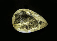 Natural Rutil quartz. Rutil quartz natural stone facet cutting with gold rutil crystals royalty free stock photography