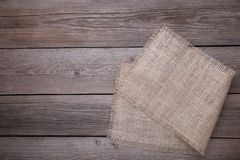 Natural sackcloth on grey wooden background. Canvas on grey wooden table. Natural sackcloth on grey wooden background stock image