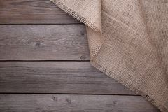 Natural sackcloth on grey wooden background. Canvas on grey wooden table stock photo