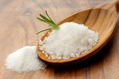 Natural salt over the spoon Royalty Free Stock Photos