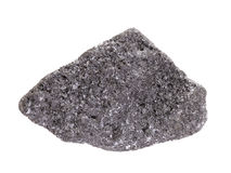 Natural sample of chromite mineral, the most important chromium ore on white background. Natural sample of chromite iron chromium oxide - mineral of spinel group stock photography
