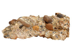 Natural sample of conglomerate rock from cemented gravel and pebbles on white background. Natural specimen of conglomerate - sedimentary rock composed of rounded stock image